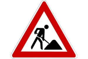 Triangular caution sign with an icon of a construction worker in the center